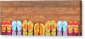 Brightly Colored Flip-flops On Wood  Canvas Print by Sandra Cunningham