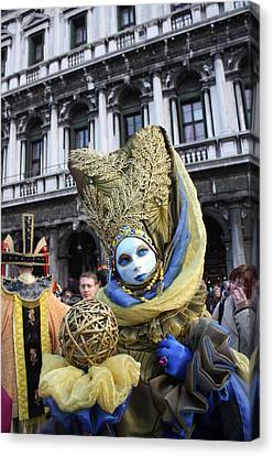 Carnival-goer In Blue And Gold Canvas Print by Pam Blackstone