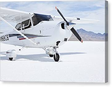 Cessna Aircraft On Bonneville Salt Flats Canvas Print by Paul Edmondson