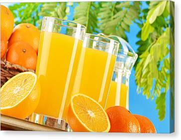 Composition With Two Glasses Of Orange Juice And Fruits Canvas Print by T Monticello