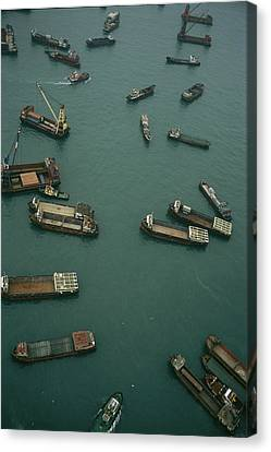 Container Ships In Hong Kong Harbor Canvas Print by Justin Guariglia