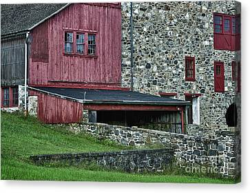 Field Stone Barn Canvas Print by John Greim