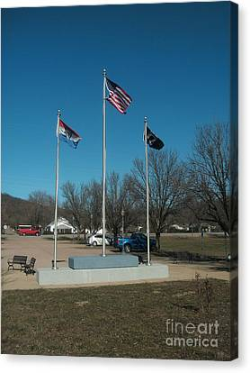 Flags With Blue Sky Canvas Print by Kip DeVore