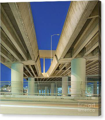 Freeway Overpass Support Structure At Night Canvas Print by Eddy Joaquim