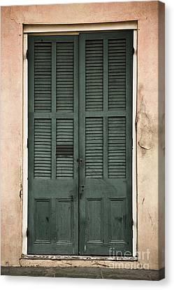 French Quarter Doors Canvas Print by Leslie Leda