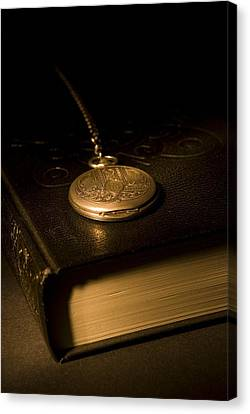 Gold Pocket Watch Resting On A Book Canvas Print by Philippe Widling