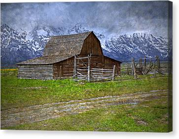 Grand Teton Iconic Mormon Barn Fence Spring Storm Clouds Canvas Print by John Stephens