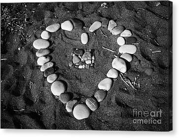 Heart Symbol Made Out Of Pebbles On The Beach At Aphrodites Rock Petra Tou Romiou Cyprus Canvas Print by Joe Fox