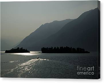 Islands On A Lake With Mountain Canvas Print by Mats Silvan