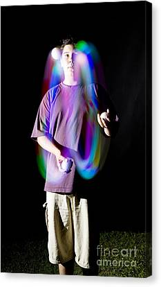Juggling Light-up Balls Canvas Print by Ted Kinsman