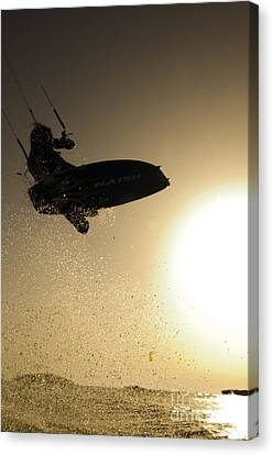 Kitesurfing At Sunset Canvas Print by Hagai Nativ