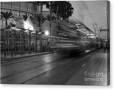 Late For The Trolley Canvas Print by Eddie Yerkish