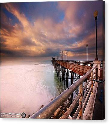 Long Exposure Sunset At The Oceanside Canvas Print by Larry Marshall