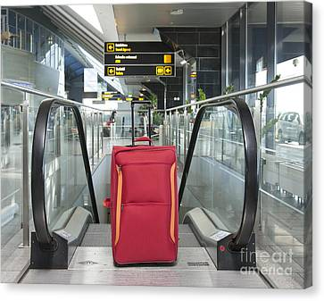 Luggage At The Top Of An Escalator Canvas Print by Jaak Nilson