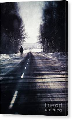 Man Walking On A Rural Winter Road Canvas Print by Sandra Cunningham
