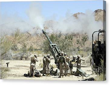 Marines Shoot 100-pound Rounds Canvas Print by Stocktrek Images