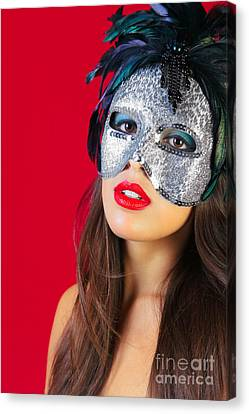 Masquerade Mask Red Background Canvas Print by Richard Thomas
