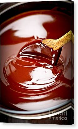 Melted Chocolate And Spoon Canvas Print by Elena Elisseeva