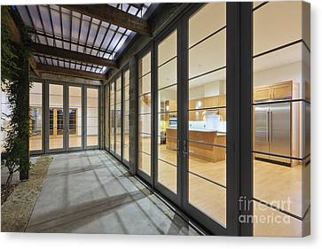 Modern Home Kitchen Through Glass Doors Canvas Print by Jeremy Woodhouse