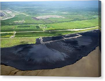 Oil Plant Settling Pond Canvas Print by David Nunuk