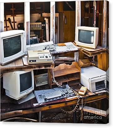 Old Computers In Storage Canvas Print by Eddy Joaquim