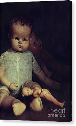 Old Dolls Sitting On Wooden Table Canvas Print by Sandra Cunningham