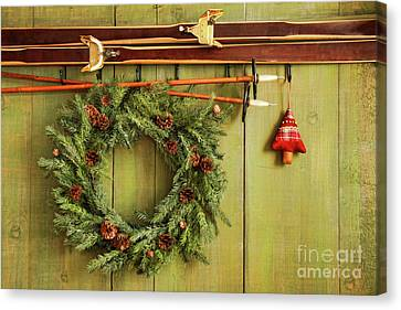 Old Pair Of Skis Hanging With Wreath Canvas Print by Sandra Cunningham