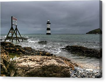 Penmon Point Canvas Print by Adrian Evans