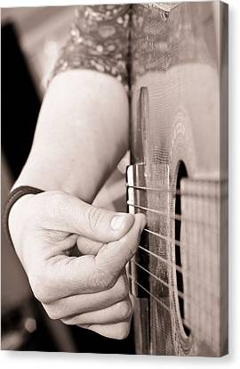 Playing Guitar Canvas Print by Tom Gowanlock
