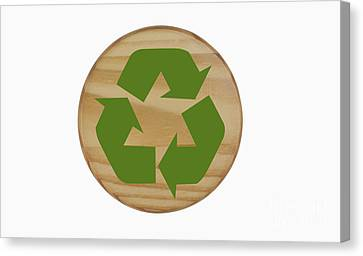 Recycling Symbol On Wood Canvas Print by Blink Images