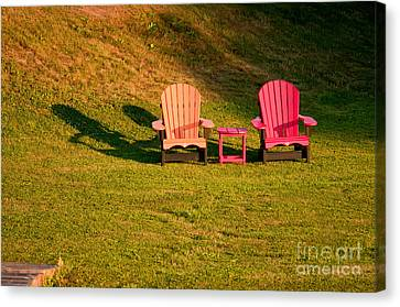 Canvas Print featuring the photograph Red And Orange Chairs by Les Palenik