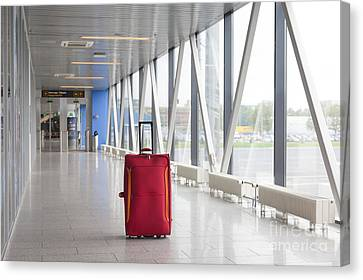 Rolling Luggage In An Airport Concourse Canvas Print