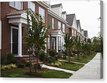 Side Porch Canvas Print - Rows Of New Townhomes by Roberto Westbrook