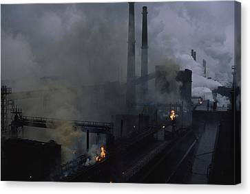 Smoke Spews From The Coke Production Canvas Print by James L. Stanfield