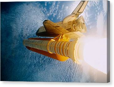 Space Shuttle In Space Canvas Print by Stocktrek