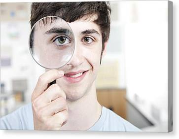 Teenage Boy With Magnifying Glass Canvas Print by