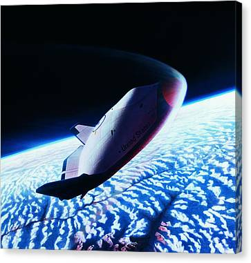 The Space Shuttle Re-entering The Earth's Atmosphere Canvas Print by Stockbyte