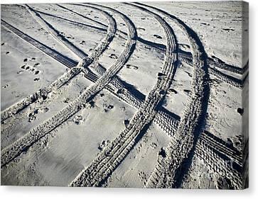 Tire Tracks And Footprints, Long Beach Peninsula, Washington Canvas Print by Paul Edmondson