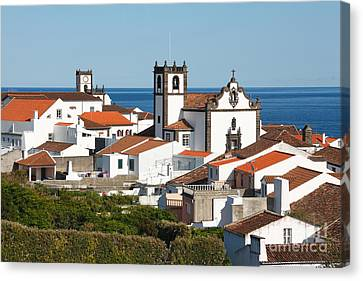Town By The Sea Canvas Print by Gaspar Avila
