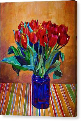 Tulips In Blue Glass Canvas Print by David Lloyd Glover