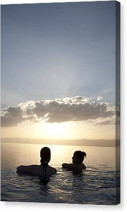 Two Friends Enjoy The Sunset Canvas Print by Taylor S. Kennedy