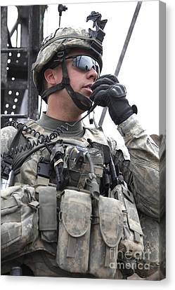 U.s. Army Soldier Communicates Canvas Print by Stocktrek Images