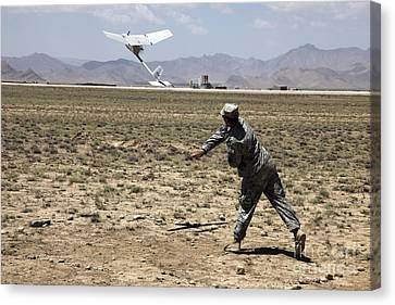 U.s. Army Soldier Launches An Rq-11 Canvas Print