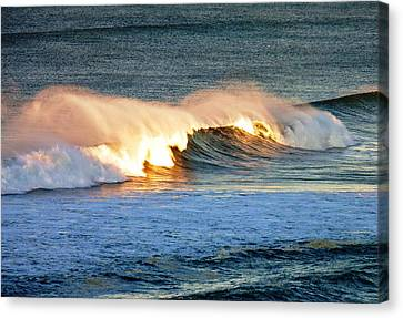 Wave At Sunrise Canvas Print by Werner Lehmann