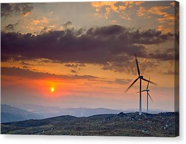Wind Turbines At Sunset Canvas Print by Andre Goncalves