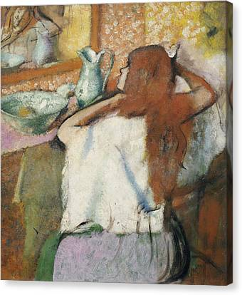 Woman Combing Her Hair Canvas Print - Woman At Her Toilet by Edgar Degas