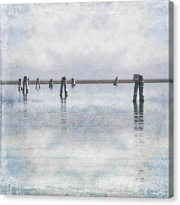 wood piles in the lagoon of Venice Canvas Print