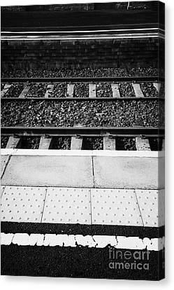 Yellow Warning Line And Textured Contoured Tiles Railway Station Platform And Track Northern Ireland Canvas Print by Joe Fox