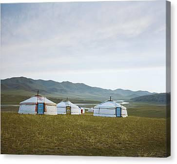 Yurts On The Wide Grassy Plains Of Mongolia Canvas Print