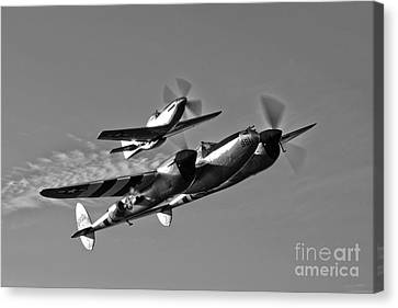 A P-38 Lightning And P-51d Mustang Canvas Print by Scott Germain